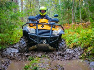 ATV in the forest in mud