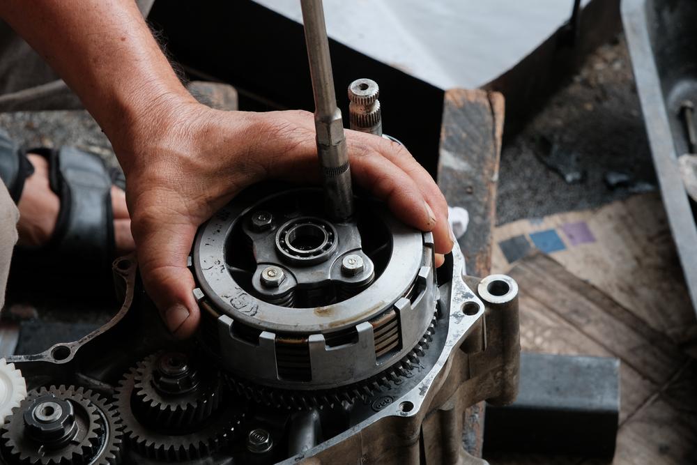 mechanic assembling a dirt bike clutch